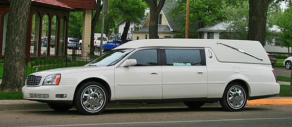 Our white conventional Cadillac hearse.
