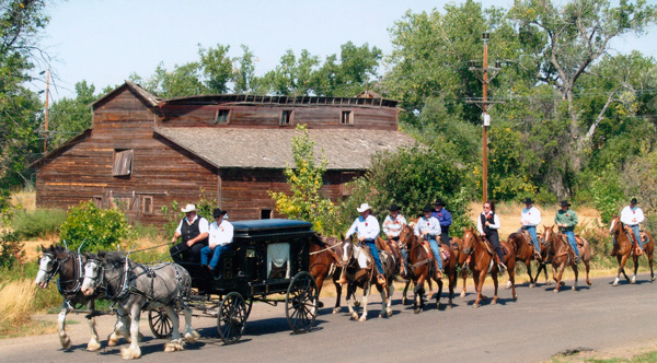 Montana funeral processions often include family members riding horseback behind the horse-drawn hearse.